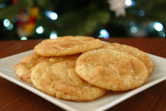 snickerdoodles on plate in front of Christmas tree