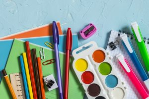 School supplies and accessories on a blue background.