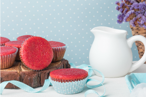 red velvet cupcakes, white pitcher, aqua background