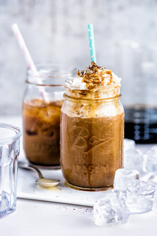 Vietnamese style iced cold brew coffee with whipped cream and caramel