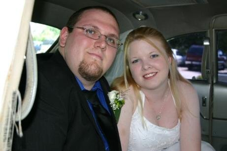 My husband and I after our wedding in a limo