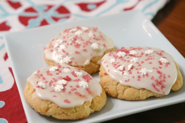 sugar cookies with peppermint icing on plate with Christmas napkin