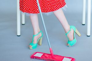 women in retro red with white polka dots dress, aqua high heels, mopping floor