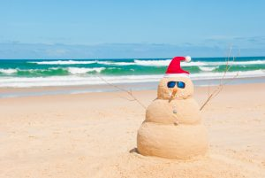 Snowman on holidays made out of sand instead of snow