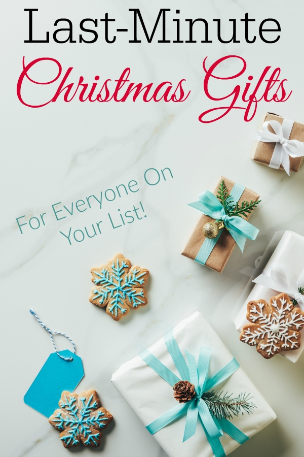Christmas gifts with aqua ribbons and tags and snowflake cookies