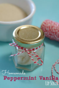 peppermint vanilla lip scrub in jar with red and white baker's twine and bowl of sugar