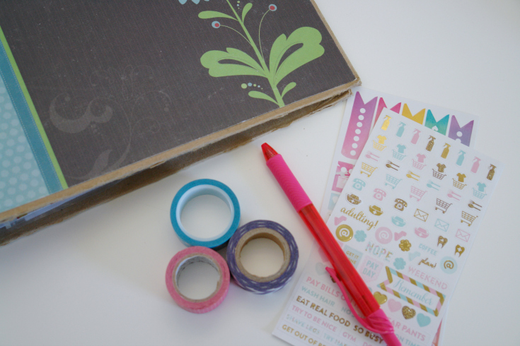 binder, washi tape, stickers, and a pen