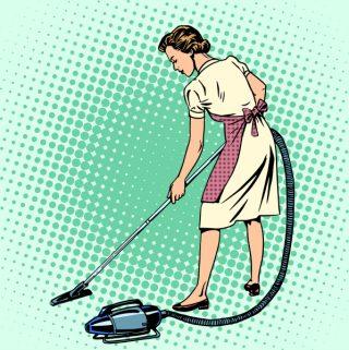retro woman vacuuming the room