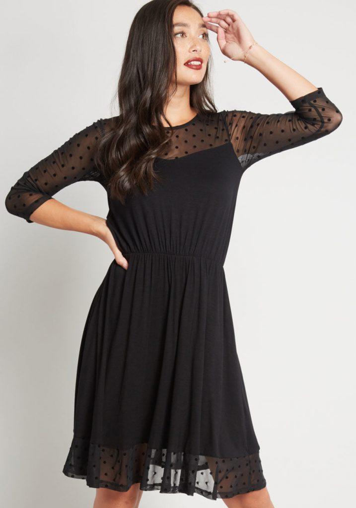 Woman in black knit dress