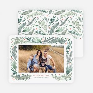 family photo on card with pine design