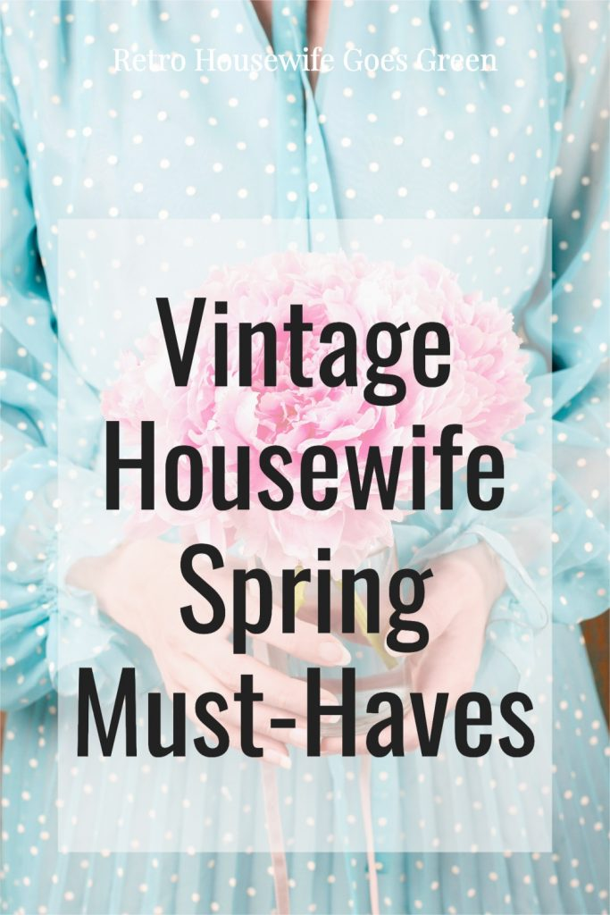 woman wearing an aqua and white polka dress holding pink flowers with text that reads vintage housewife spring must-haves