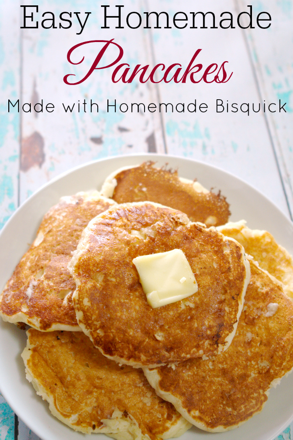 stack of homemade pancakes with butter on white plate on aqua and white wooden table