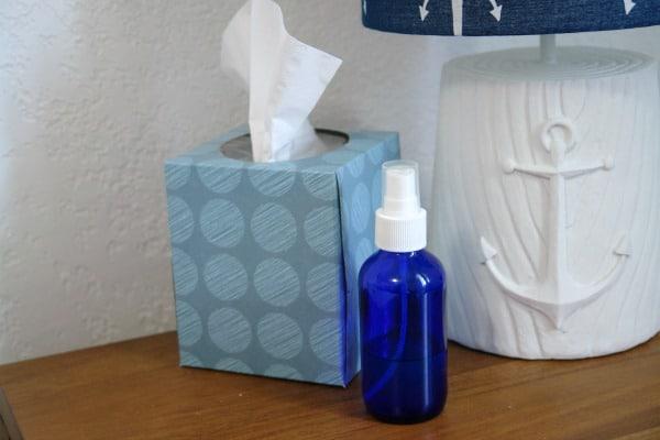 lamp, tissue box and sleep linen spray on nightstand