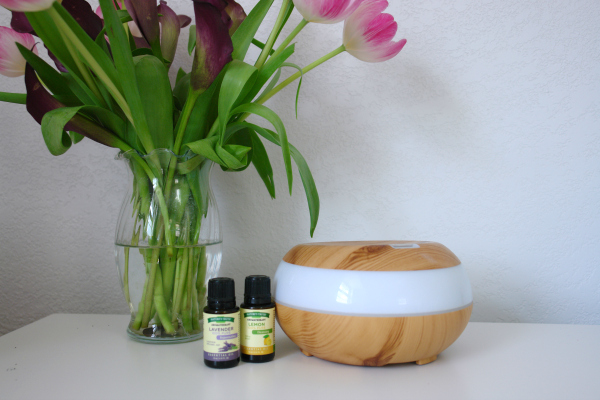 essential oils with flowers and a diffuser
