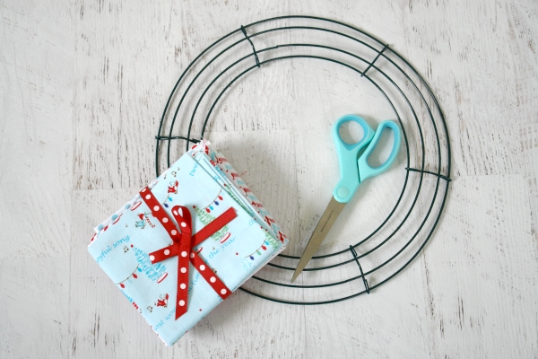 fabric, wreath form and scissors