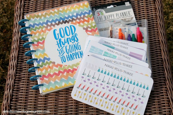 Create 365 Happy Planner on wicker table with planner supplies
