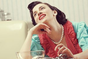 Vintage portrait of a happy housewife in the kitchen