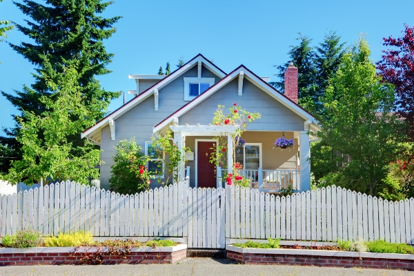 vintage blue home with white picket fence