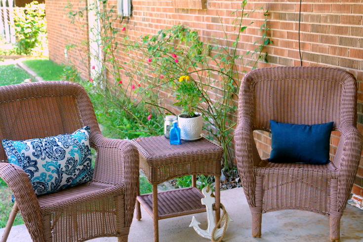 porch furniture, pillows, and decor