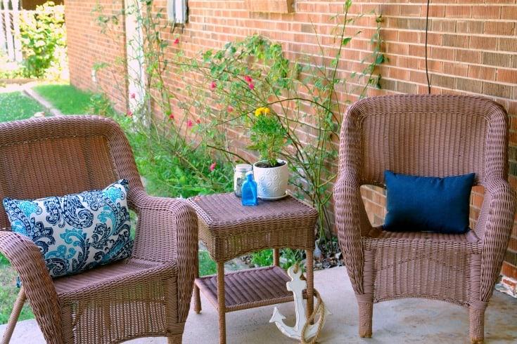 porch furniture, pillows, and decor