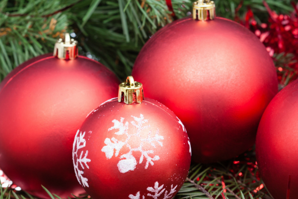 vertical Christmas still life - few red Christmas balls on Xmas tree background