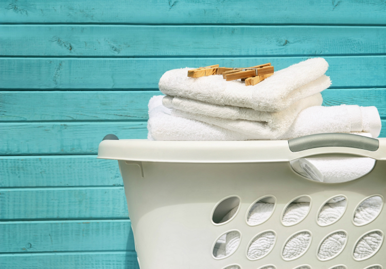 laundry basket in front of aqua wall