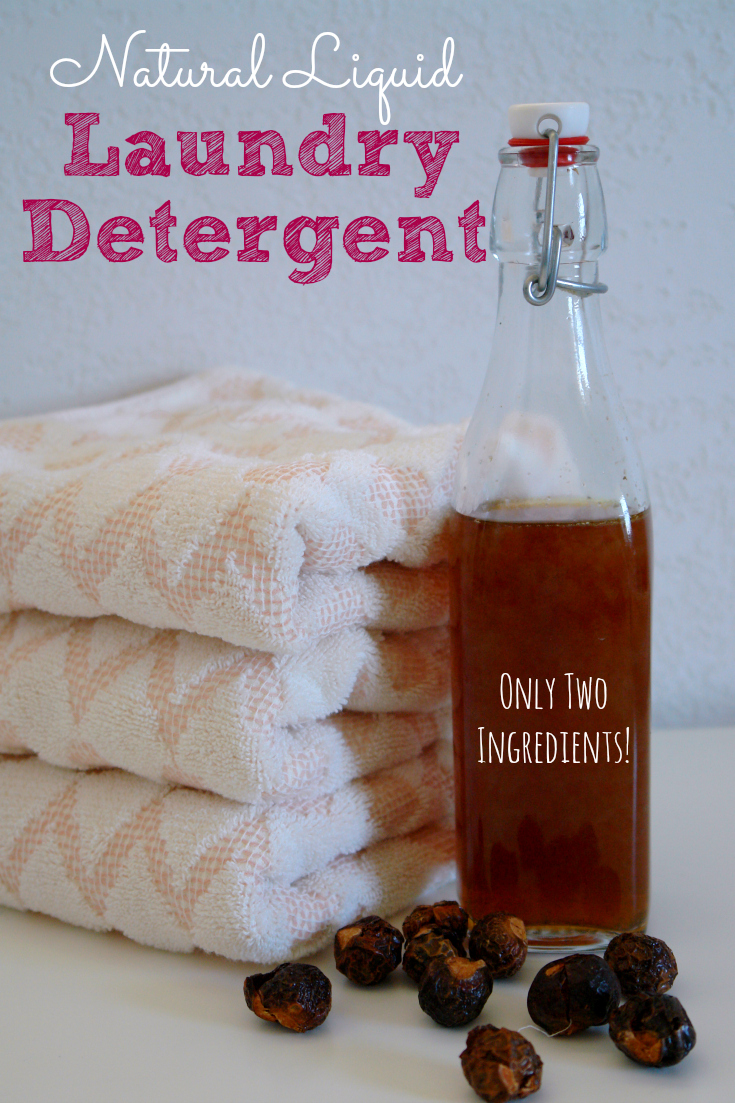 bottle of soap nut laundry detergent, with towels and soap nuts