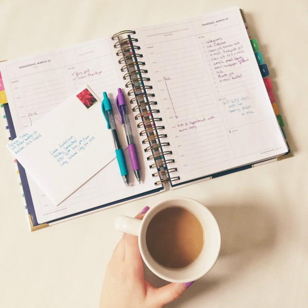 planner and coffee on table