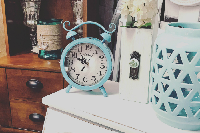 aqua clock on dresser