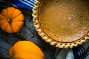pumpkins and pumpkin pie on table
