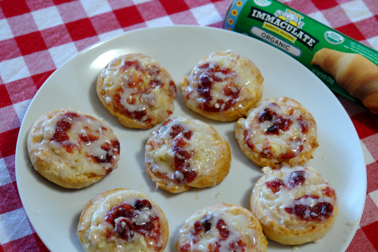 cranberry cream cheese danishes on white plate
