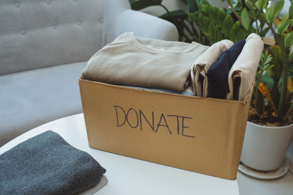 Donation box and casual clothes in living room