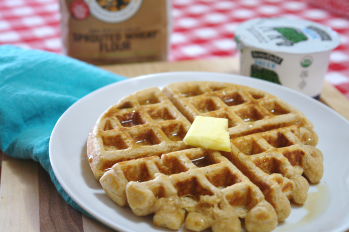 photo of waffle with butter and syrup