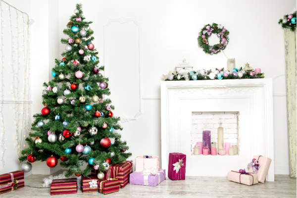 christmas tree by a fireplace