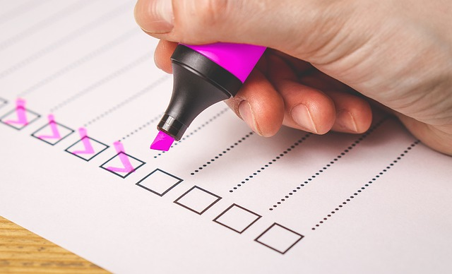 person marking off checklist