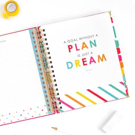 Colorful Living Well planner open with accessories