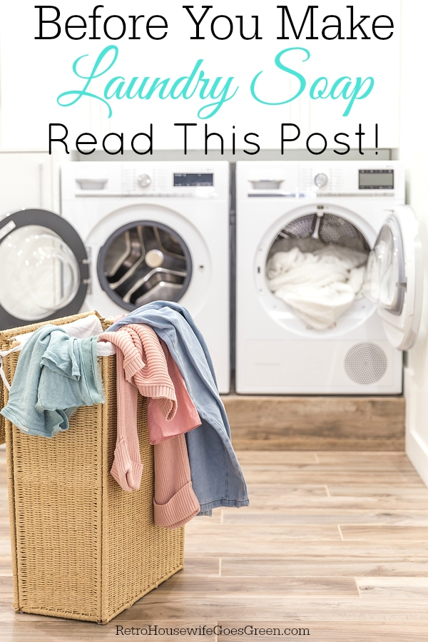 Laundry basket with dirty clothes with washing and drying machines on the background