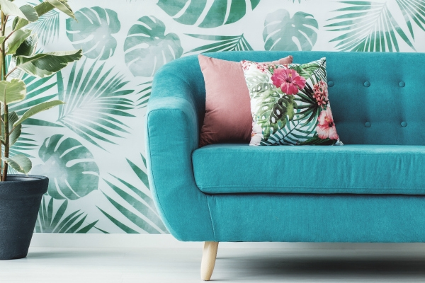 turquoise sofa and pink throw pillows