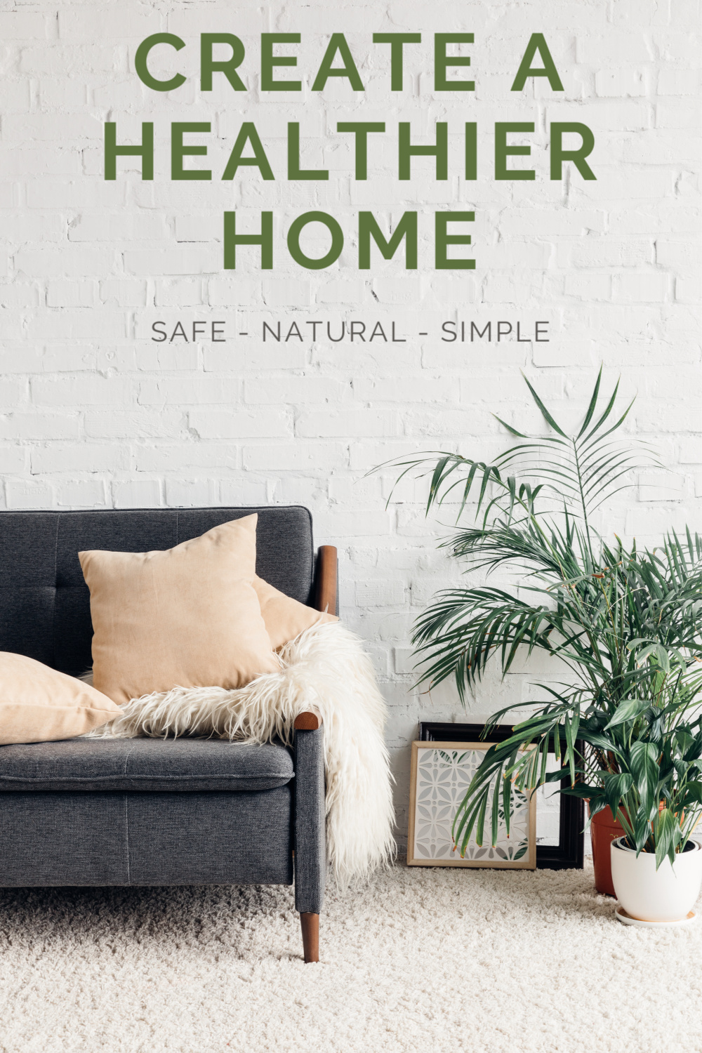 grey sofa with blankets and pillow and plants
