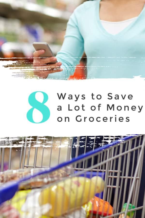 woman pushing shopping cart and looking at phone