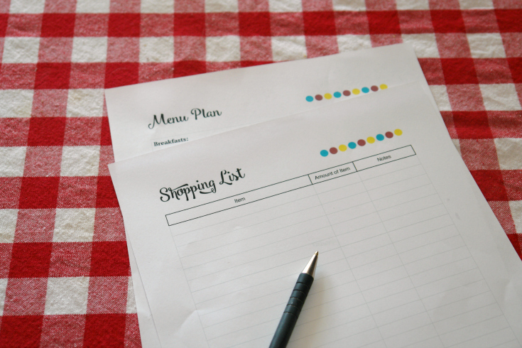 Meal planning printables on table with pen