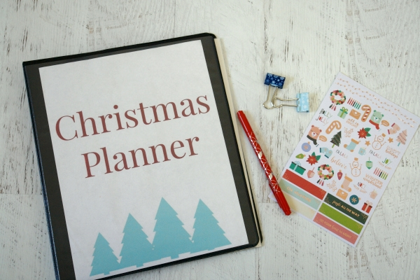 Christmas planner with pen, stickers, and binder clips