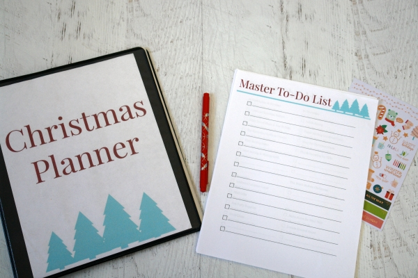 Christmas planner, planner sheets, pen, and stickers