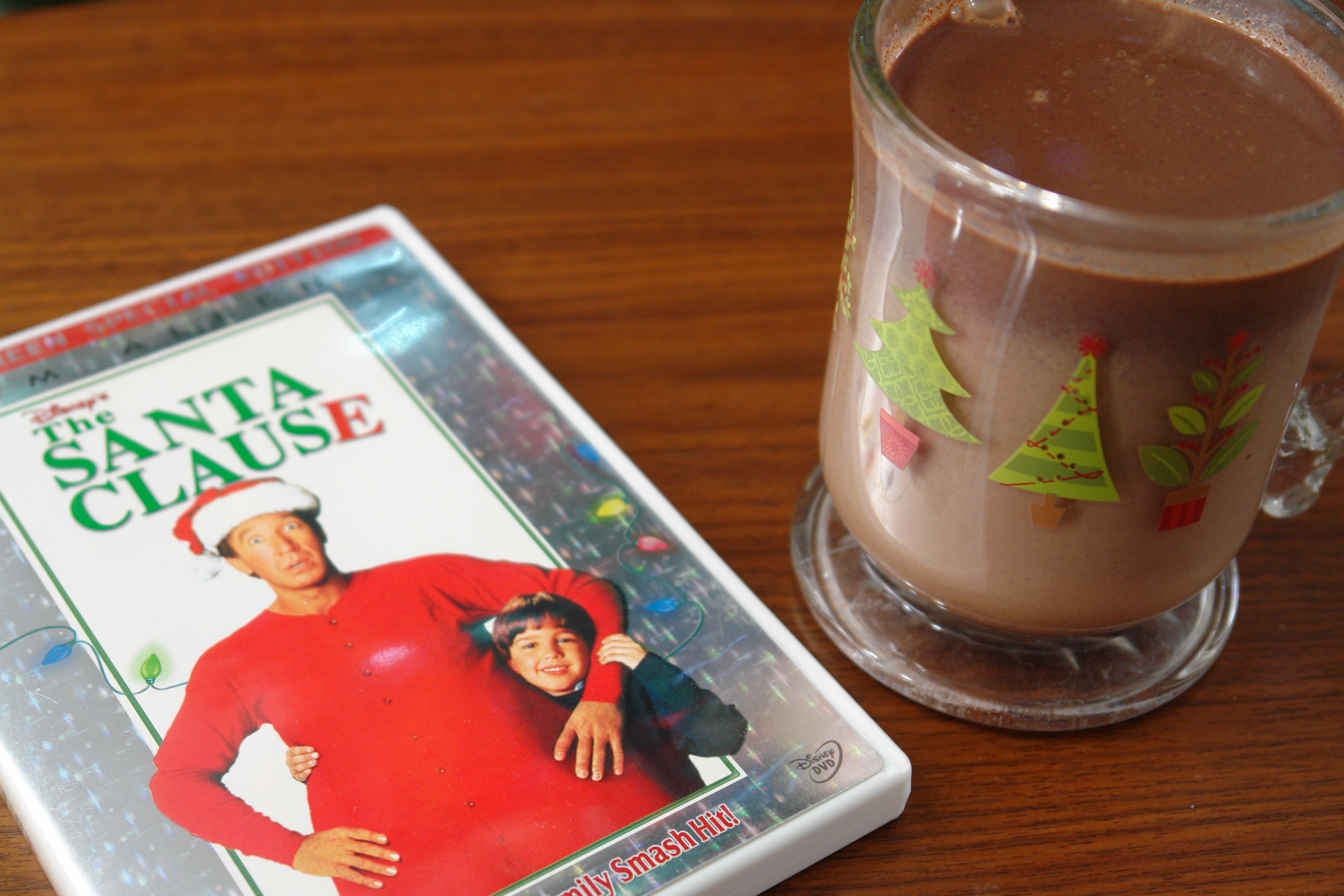 Hot chocolate in Christmas mug with DVD copy of The Santa Clause