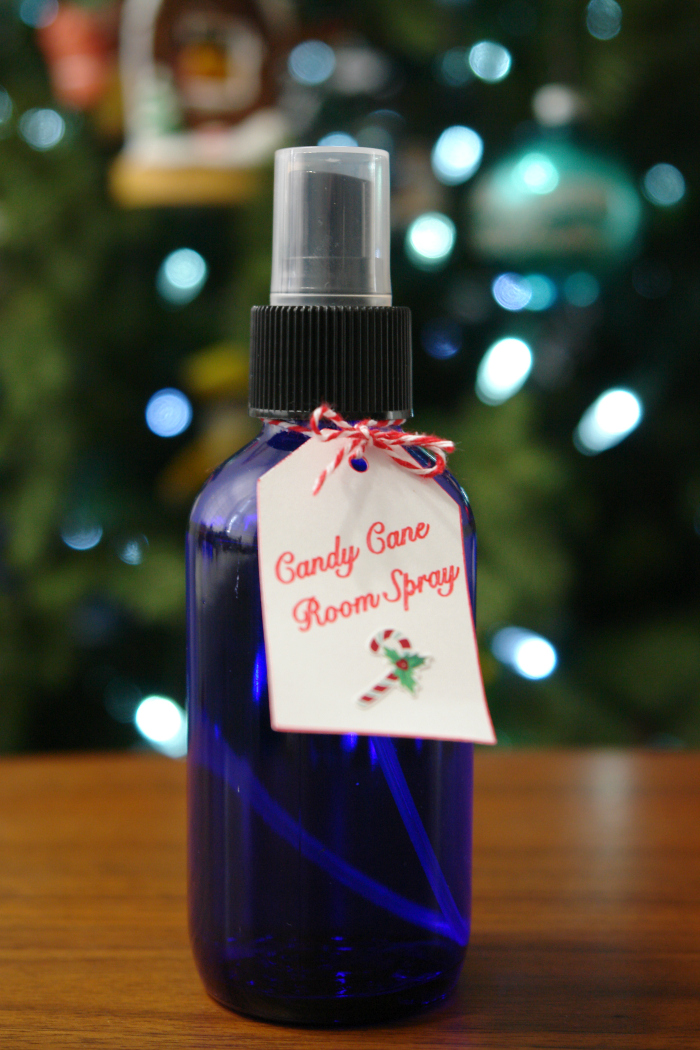 blue spray bottle in front of Christmas tree