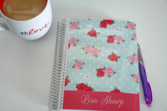 planner on desk with cup of tea