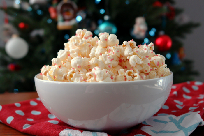 Bowl of White Chocolate Peppermint Popcorn in from of Christmas tree