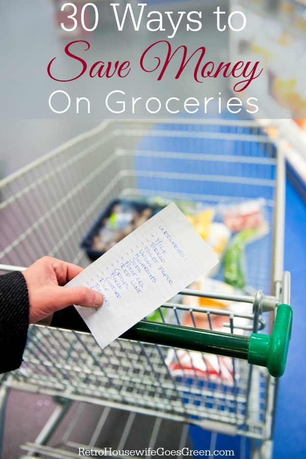 person holding grocery list and pushing cart