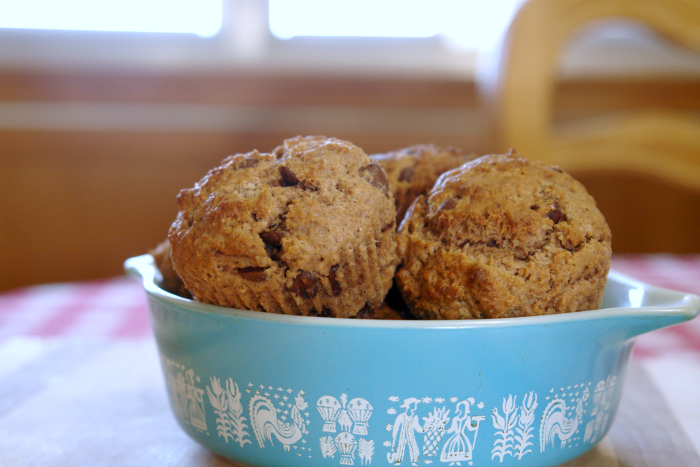 chocolate chocolate chip muffins in vintage Pyrex bowl