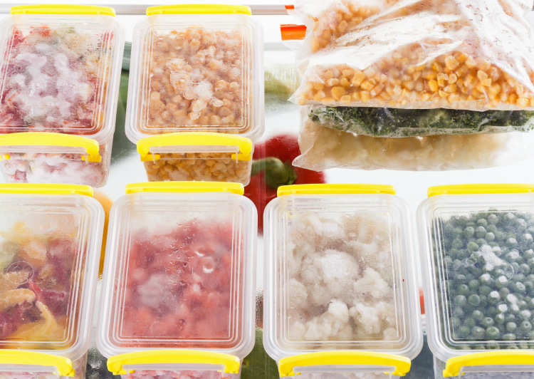 containers filled with food in freezer